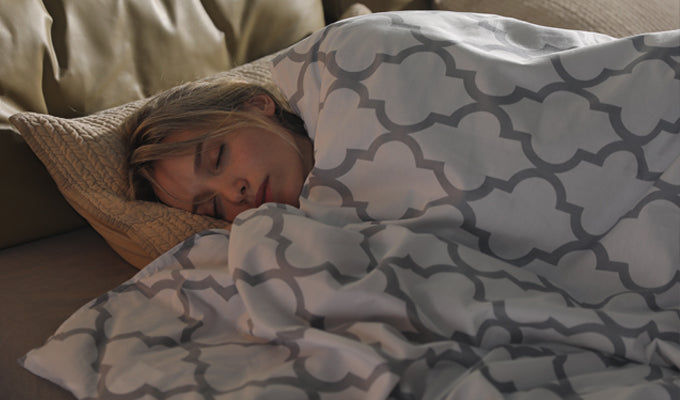 Woman Sleeping With A Patterned YNM Weighted Blanket