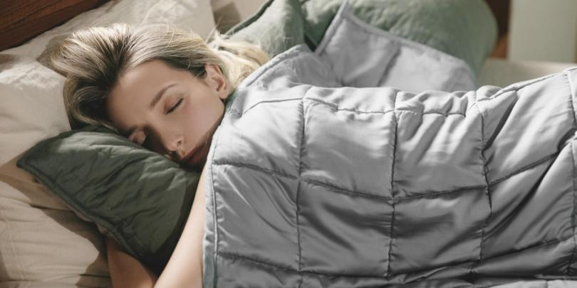 Woman Under YNM Grey Weighted Blanket On Bed