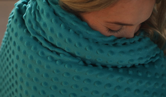Woman Wrapped In A Green YNM Minky Weighted Blanket