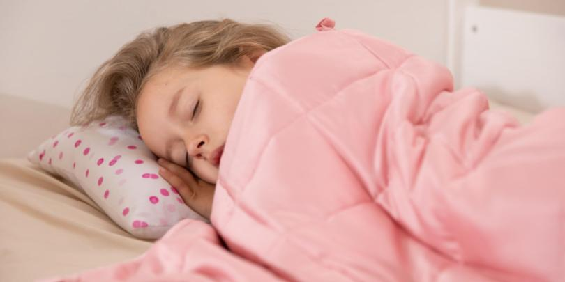 Young Girl Asleep Under YNM Weighted Blanket