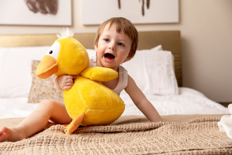 Child plays with weighted duck toy