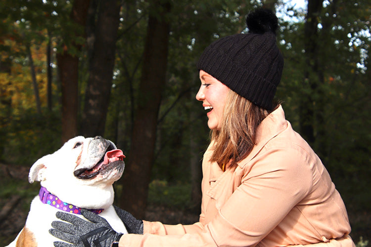 English bulldog and woman in the woods.