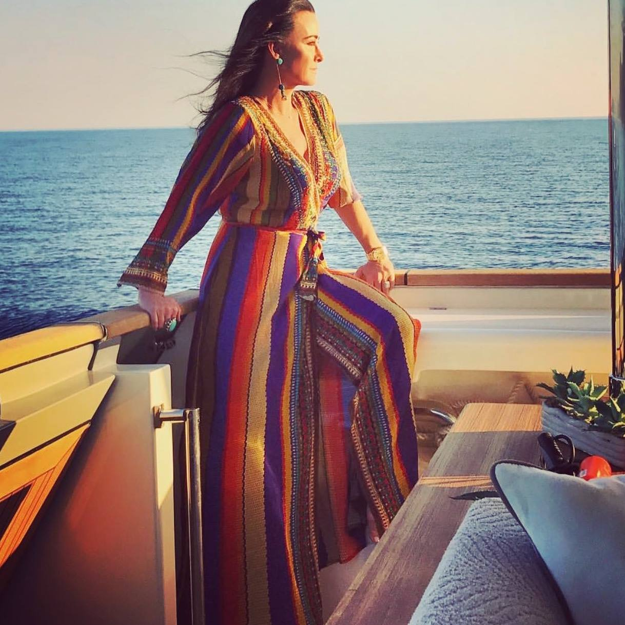 Kyle Richards vacation in stripe wrap dress