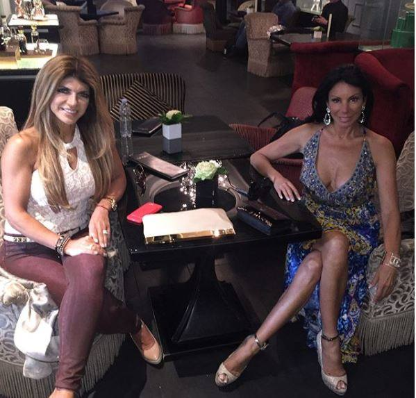 Danielle Staub, tv personality from the Real Housewives of New Jersey, appears in season 8 in a fabulous Shahida Parides Persian Princess printed dress