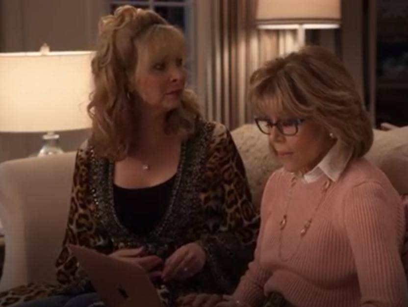 Lisa Kudrow from the Friends tv show, appeared wearing a Shahida Parides animal print wrap dress on the set of the Netflix Original Grace and Frankie.