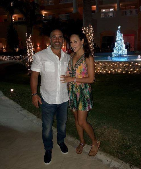RHONJ, Melissa Gorga, wears Shahida Parides' short cocktail dress with a deep v-neckline during her New Year's Eve celebration in Jamaica with her family.