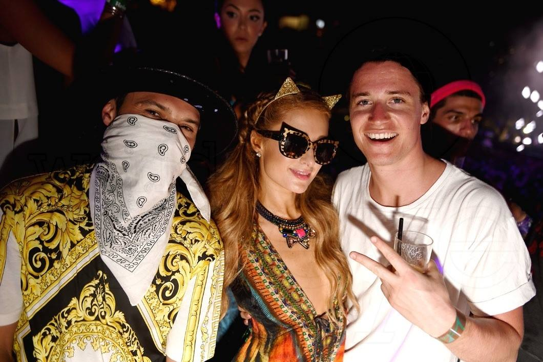 Paris Hilton in Shahida Parides with Kygo and Alec Monopoly at Ultra Music Festival 2016