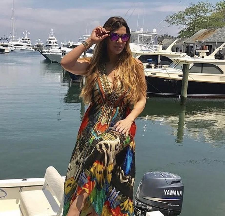 Siggy from Real Housewives of New Jersey reality series, shows off her Parrot Macaw Dark maxi dress from Shahida Parides during her stay in Massachusetts.