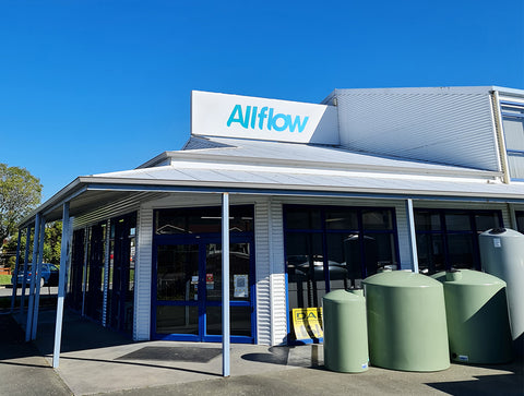 An exterior view of the front door and signage at the Allflow retail store.