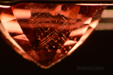 Spinel Inclusions dislocations in orange - red spinel