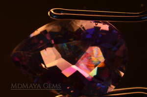 Interference figures in Untreated Amethyst from Brazil 5.35 ct, checkerboard pear cut