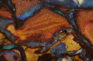 Top Koroit Boulder Opal 15.23 ct under microscope