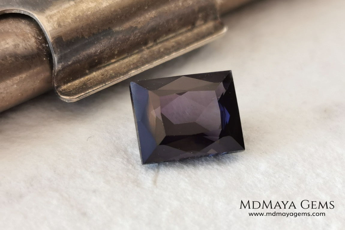 Beautiful Dark Purple Spinel from Sri Lanka. Rectangle cut. 1.80 ct. A natural and untreated gemstone for your personalized jewelry at an affordable price.   Regarding the color, I would like to make a precision, the violet color has a bluish component and the purple has a reddish one. This gem, depending on how the light falls on it, looks purple or violet.