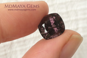 Large dark grayish reddish purple Spinel 5.30 ct under daylight