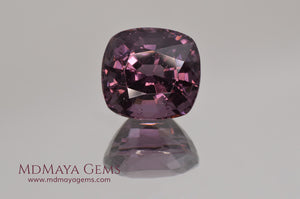 Large dark grayish reddish purple Spinel 5.30 ct under incandescent light