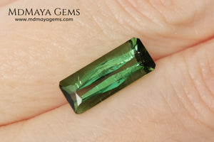 Green Tourmaline. 2.74 ct. Baguette cut. This elongated green stone shows a vivid and bright color. Its behavior under any type of light is marvelous, this pretty gem will look perfect in any kind of jewelry.