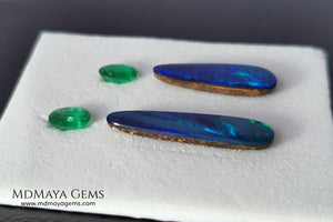 Opal Doublets and Emeralds. This set is composed by a pair of bright Australian Opal doublet and two vivid Zambian Emeralds. The perfect combination for your bespoke jewelry.