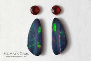 Opal Doublets and Red Garnets. This set is composed by a pair of bright Australian Opal doublet and two vivid Garnets. The perfect combination for your bespoke jewelry.