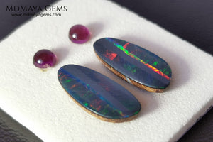 Opal Doublets and Umbalite Garnets. This set is composed by a pair of bright Australian Opal doublet and two vivid Umbalites. The perfect combination for your bespoke jewelry.