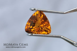 Natural Orange Tourmaline from Tanzania. 1.35 ct. Trillion cut. Rare gemstone with a beautiful honey color. It will look perfect in any piece of jewelry.
