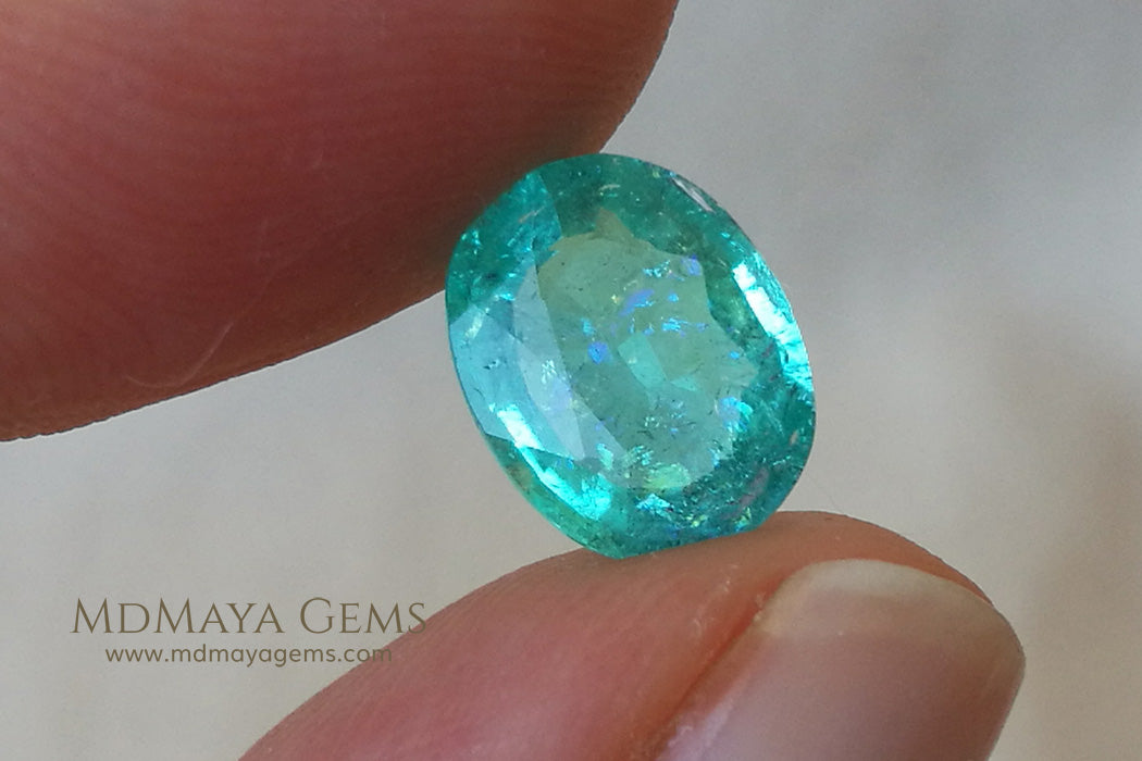 Neon Greenish Blue African Paraiba Tourmaline Oval Cut 2.43 ct under daylight