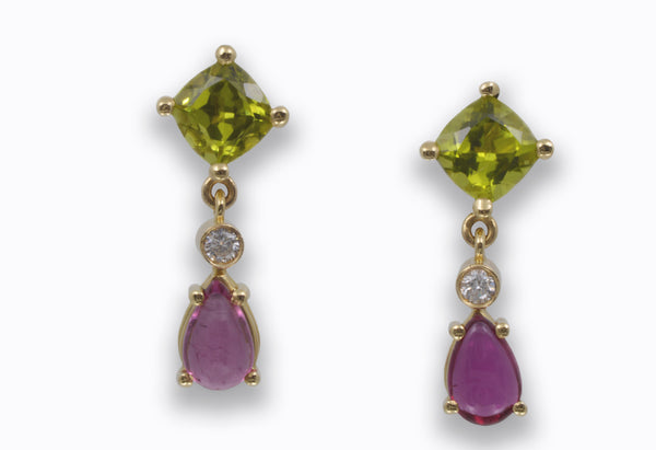 Glamorous and Elegant Earrings in 18 k. yellow gold with Peridots, Rubellite Tourmalines and Diamonds
