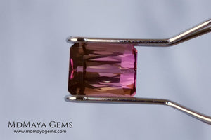 Beautiful Bi Color Pink - Orange Tourmaline. Octagon Cut. 1.47 ct. Eye Clean and Perfect Cut.  Two-tone pink tourmaline, this gemstone shows two shades, one duller and the other more saturated and alive, depending on how it moves under the light you can see its different shades.