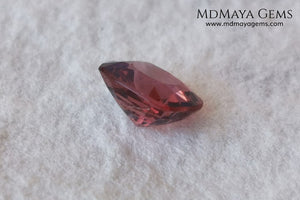 Red - Orange Spinel. Cushion Cut. 1.11 cts. Beautiful untreated gem for your personalized jewelry. This beautiful spinel is so inexpensively priced due to a fracture in the pavilion, it is not visible and does not affect the beauty of the gem at all.