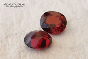 Dark Red Rhodolite Pair, 5.24 ct, oval cut. This beautiful pair of rhodolites shows a dark red color, although it is full of life and sparkles. It has a very good size and they will look incredibly beautiful on some earrings or on a pair of cufflinks.