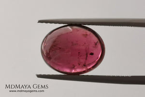 Large tourmaline rubellite, 6.16 ct, oval cabochon cut. Beautiful natural gem ideal for your personalized jewelry. This purplish red cabochon has a good size for a ring. Good price.