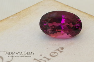 Natural Rubellite Tourmaline Oval Cut 5.15 ct under daylight