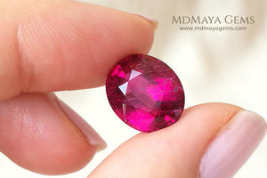 Untreated Rubellite African Tourmaline Oval Cut 5.96 ct under daylight