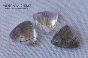 Metallic Rutilated Quartz 9.82 ct set. Outstanding set of rutilated quartz with beautiful inclusions. Perfect for your custom jewelry.  2.73 ct .. 9.93 * 9.83 * 4.73 mm 3.94 ct .. 10.23 * 10.35 * 5.80 mm 3.15 ct .. 9.93 * 9.72 * 5.39 mm