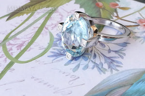Luxury Light Blue Topaz and diamond ring in 18k white gold.