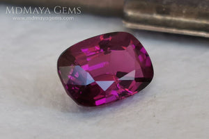 Reddish Purple Umbalite (Rhodolite Garnet), 2.03 ct, cushion cut. Elegant natural gemstone, that shows a vivid color, good cut and proportions, it will look very pretty in a ring, and at an affordable price.