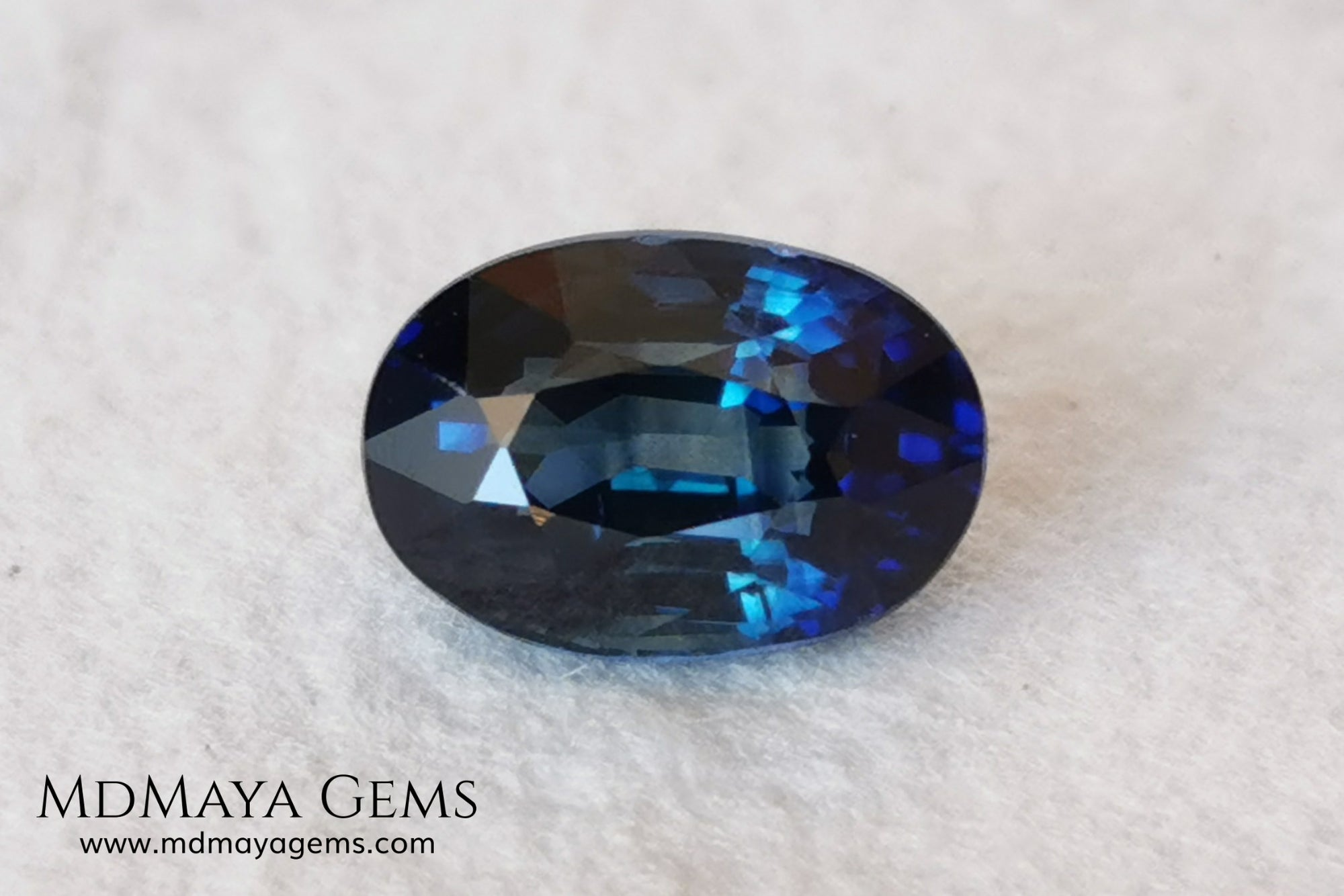 Untreated indigo blue sapphire 1.52, oval cut, certificate included.  This dark blue sapphire shows two shades of blue, one more vivid in the center of the gem and darker at the ends, its behavior under light is good, both in incandescent light and under natural light, it is a dark blue sapphire full of sparkles and life. Its elongated oval cut will be very beautiful in any piece of jewelry. This sapphire is ideal for those looking for untreated gemstones of any kind at a good price.