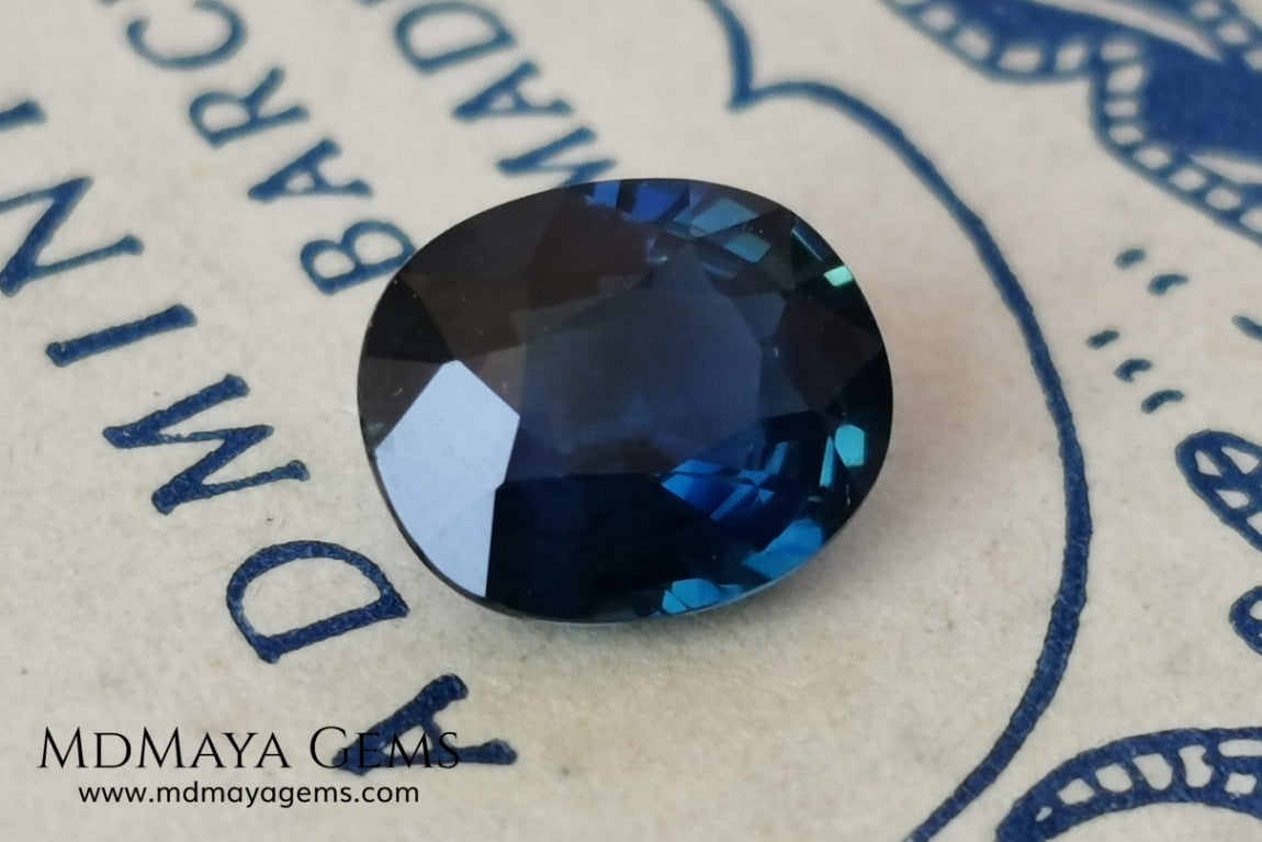 Untreated dark greenish blue sapphire 1.75 ct. Oval cut.  Amazing dark greenish blue sapphire with a good behavior under any type of light. It has a good size, and it will look perfect on your personalized jewelry, either in a ring or a pendant. It has some inclusions that although they are visible from some angles, they do not affect its beautiful at all. This amazing sapphire is ideal for those who look for precious stones without treatment of any kind.