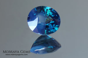 Untreated Greenish Blue Sapphire 1.79 ct, oval cut with certificate.  This greenish-blue sapphire has a very good behavior under any type of light, whether under incandescent or natural light. It has a cloudy zone, which can be seen in the photos, although it is really very beautiful gemstone, it has a very good size for a ring or any piece of jewelry. A great untreated blue sapphire at an affordable price.