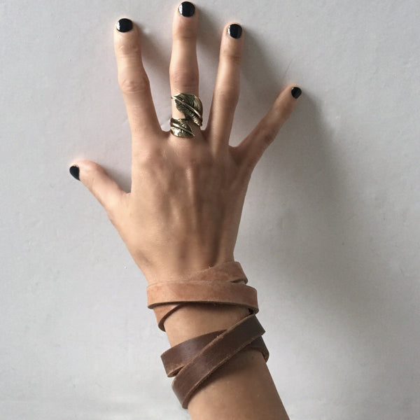 leather bracelets on woman's wrist