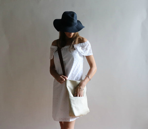 model with crossbody purse