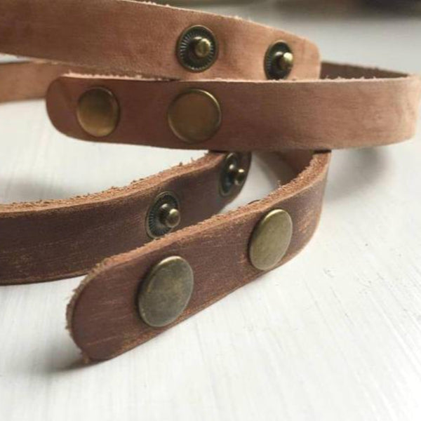 Detail of leather bracelet snaps