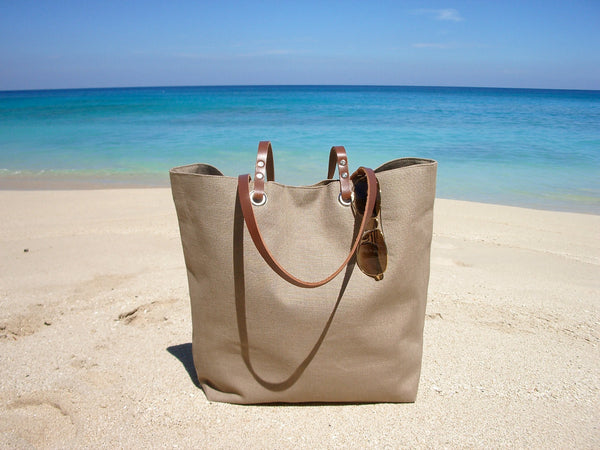 vacation bags on beach