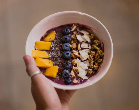 A nut granola and acai bowl packs a lot of protein and flavor as a mid-day pick-me-up!