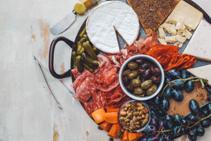 For a more significant snack or a party appetizer, try a charcuterie board that includes smoked and cured meats, cheeses, nuts, olives, fruit, and keto-friendly crackers.