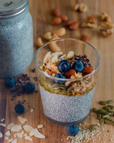 Overnight chia pudding topped with nuts, granola, and berries makes a great low carb snack.