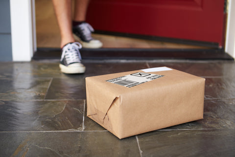 best keto delivery kits a person retrieving a package from their front porch.