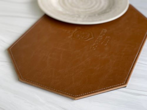 Impact brown leather placemat under a cream plate