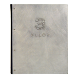 Handcrafted aluminum menu cover with embossed logo and shadow patina for Alloy