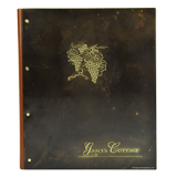Handcrafted brass menu cover with embossed and buffed logo for Grace's Cottage