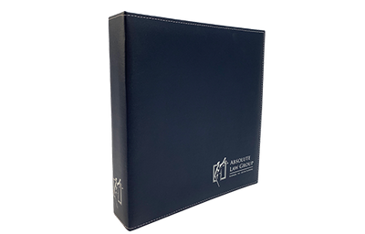 Matte Navy Blue faux leather binder with silver foil stamped logo and silver metallic corners.